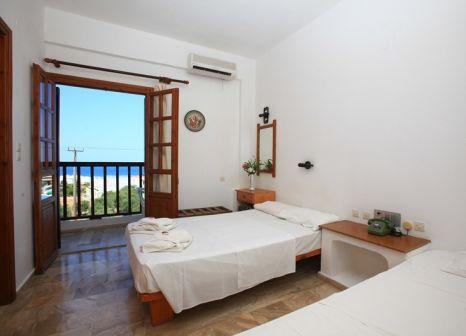 Hotelzimmer mit Mountainbike im Hotel Galini