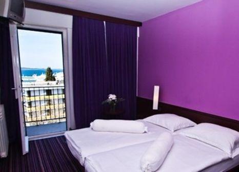 Hotelzimmer mit Mountainbike im Hotel Adriatic