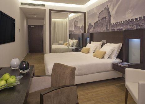 Hotelzimmer mit Mountainbike im Jupiter Lisboa Hotel