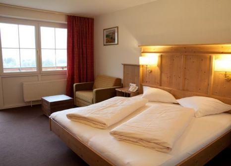 Hotelzimmer mit Tennis im Harmony Hotel Harfenwirt