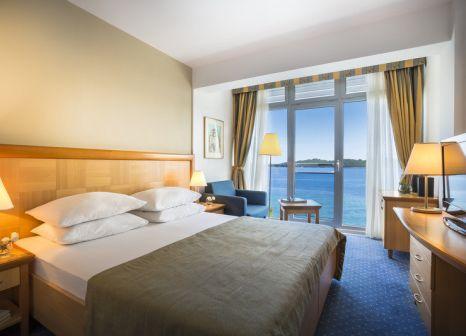 Hotelzimmer mit Mountainbike im Aminess Grand Azur Hotel