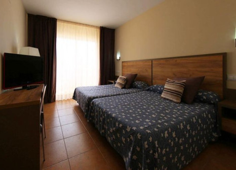Hotelzimmer mit Mountainbike im Gran Hotel La Hacienda