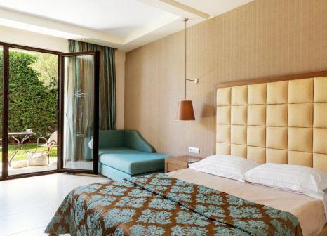 Hotelzimmer mit Mountainbike im Mediterranean Village Hotel & Spa