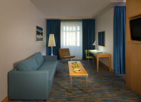 Hotelzimmer mit Mountainbike im Radisson Blu Hotel Muscat