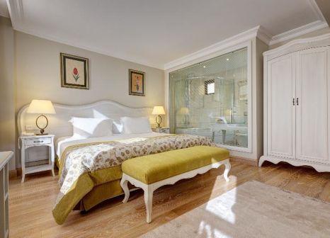 Hotelzimmer mit Hochstuhl im Arena Hotel