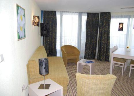 Hotelzimmer mit Mountainbike im Hotel Slavuna