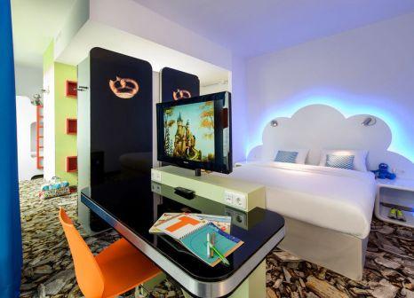 Hotelzimmer mit Animationsprogramm im Hotel ibis Styles Muenchen Ost Messe