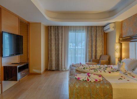 Hotelzimmer mit Tischtennis im Golden Rock Beach Hotel