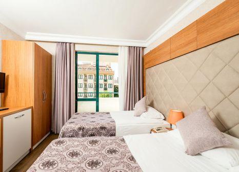 Hotelzimmer mit Mountainbike im Grand Seker Hotel