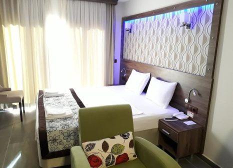Hotelzimmer mit Restaurant im Dolphin Apart & Hotel