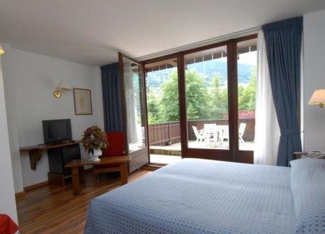 Hotelzimmer mit Tischtennis im Hotel & Residence Baita Clementi