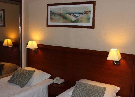 Hotelzimmer mit Mountainbike im Hotel Sao Mamede