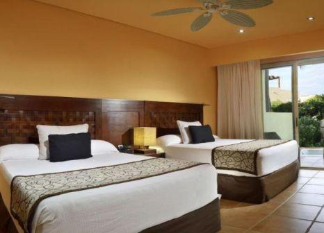 Hotelzimmer mit Mountainbike im Catalonia Yucatan Beach Resort & Spa