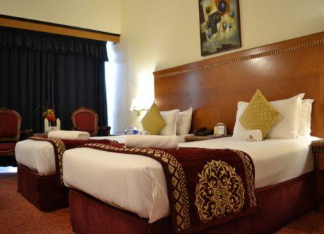 Hotelzimmer mit Tennis im Ramee Guestline Hotel Al Rigga