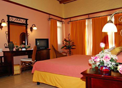 Hotelzimmer mit Mountainbike im Iberostar Colonial