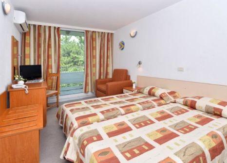 Hotelzimmer mit Mountainbike im Hotel Althea
