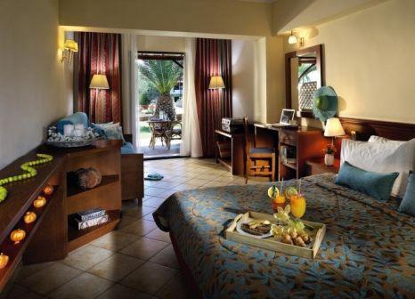 Hotelzimmer mit Mountainbike im Blue Dolphin Hotel