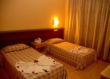 Hotelzimmer mit Mountainbike im Elit Köseoglu Hotel