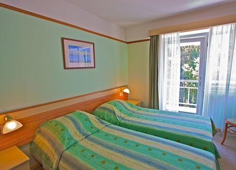 Hotelzimmer mit Mountainbike im Park Plaza Arena Pula
