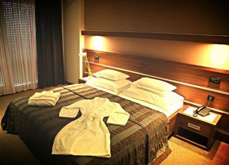 Hotelzimmer mit Paddeln im Hotel Plaza