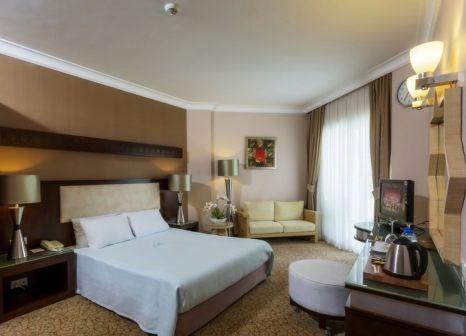 Hotelzimmer mit Mountainbike im Mukarnas Spa Resort