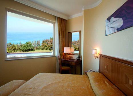 Hotelzimmer mit Mountainbike im Hotel Tirreno