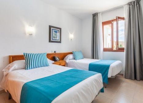 Hotelzimmer mit Mountainbike im BlueSea Gran Playa