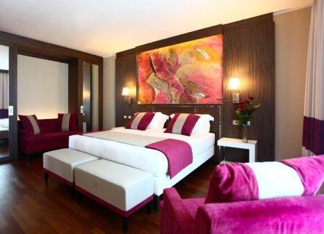Hotelzimmer mit Mountainbike im Ramada Plaza Milano