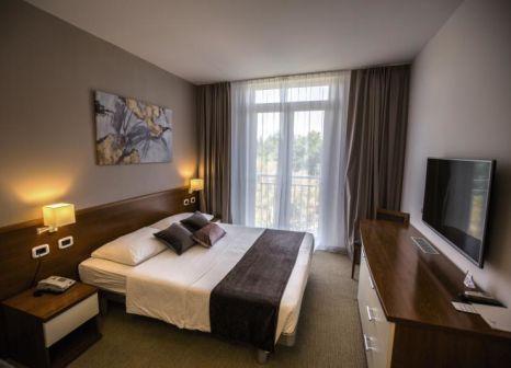 Hotelzimmer mit Volleyball im Arena Hotel Holiday