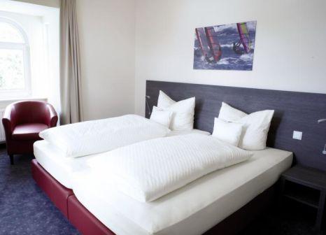 Hotelzimmer mit Mountainbike im Sporthotel Bloemfontein