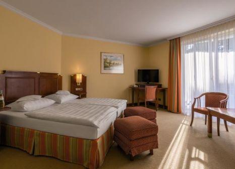 Hotelzimmer mit Mountainbike im KAISER SPA Hotel zur Post