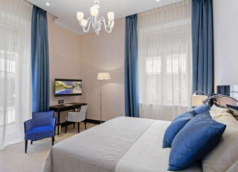 Hotelzimmer mit Mountainbike im Boutique Hotel Alhambra & Villa Augusta