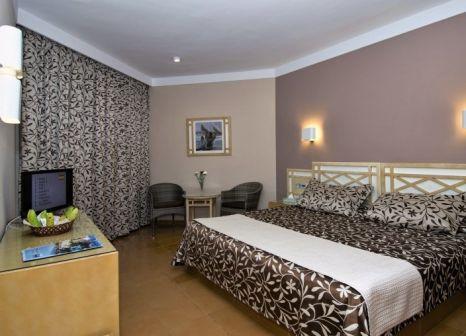 Hotelzimmer mit Mountainbike im Puerto Palace
