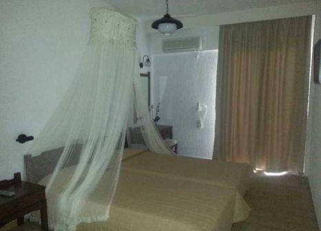 Hotelzimmer mit Mountainbike im Dimitra