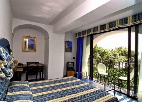 Hotelzimmer mit Hochstuhl im La Conca Azzurra