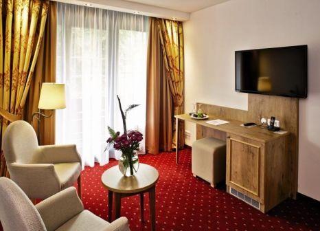 Hotelzimmer mit Mountainbike im Vital Resort Mühl