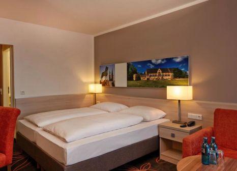 Hotelzimmer mit Ski im H+ Hotel Goslar