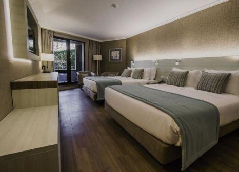 Hotelzimmer mit Mountainbike im Enotel Lido