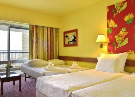 Hotelzimmer mit Mountainbike im Pestana Delfim All Inclusive