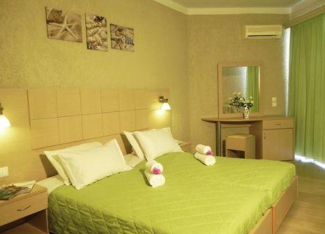 Hotelzimmer mit Mountainbike im Alkionis