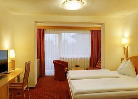 Hotelzimmer mit Mountainbike im Der Schütthof