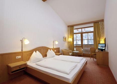Hotelzimmer mit Tischtennis im AlpineResort Zell am See