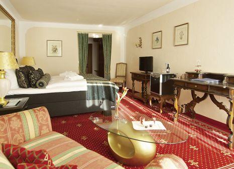 Hotelzimmer mit Ski im Ludwig Royal Golf & Alpin Wellness Resort