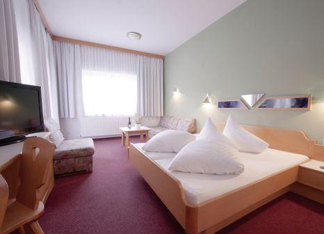 Hotelzimmer mit Ski im Alpenfriede