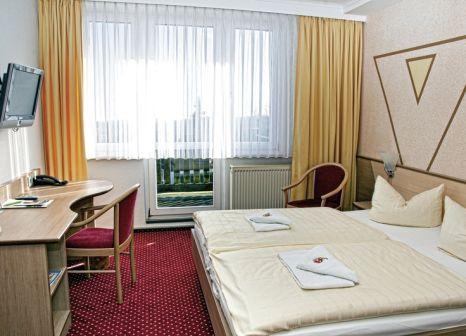Hotelzimmer mit Mountainbike im Oberhof Sporthotel