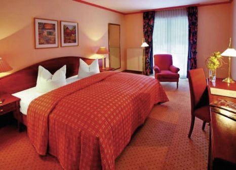 Hotelzimmer mit Mountainbike im Hotel Döllnsee-Schorfheide