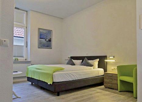 Hotelzimmer mit Mountainbike im Parkhotel Wangerooge