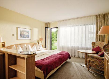 Hotelzimmer mit Mountainbike im Sporthotel & Resort Grafenwald