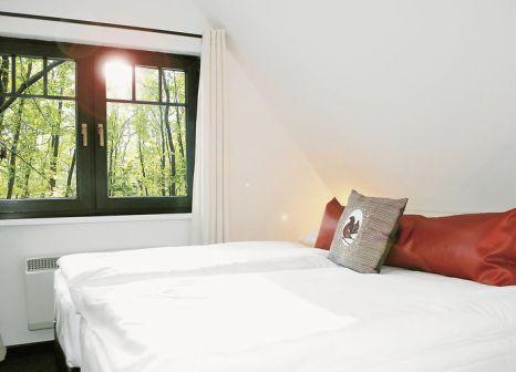 Hotelzimmer mit Mountainbike im Van der Valk Naturresort Drewitz