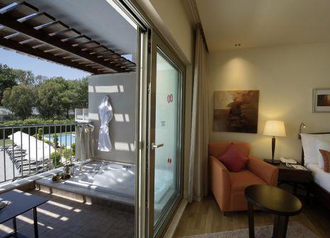 Hotelzimmer mit Yoga im Barut Hemera